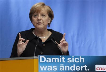 German Chancellor and head of the Christian Democratic Union (CDU) party Angela Merkel delivers a speech to promote CDU top-candiate Frank Henkel during an election rally in Berlin September 9, 2011. The sentence reads ''So that something changes''. REUTERS/Tobias Schwarz