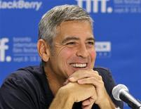 "<p>Actor George Clooney smiles during the news conference for the film ""The Descendants"" at the 36th Toronto International Film Festival September 10, 2011. REUTERS/Mike Cassese</p>"