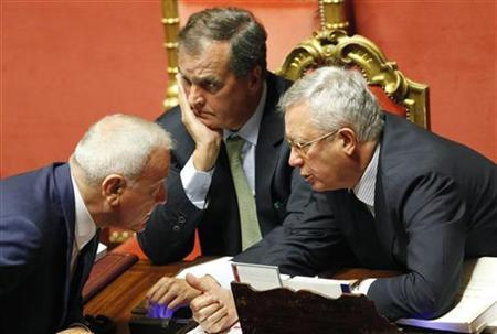 Italy's Finance Minister Giulio Tremonti (R) talks to Cabinet Undersecretary Gianni Letta, as Legislative Simplification Minister Roberto Calderoli (C) looks on, as they attend a debate before a vote at the Senate in Rome September 7, 2011. REUTERS/Alessia Pierdomenico