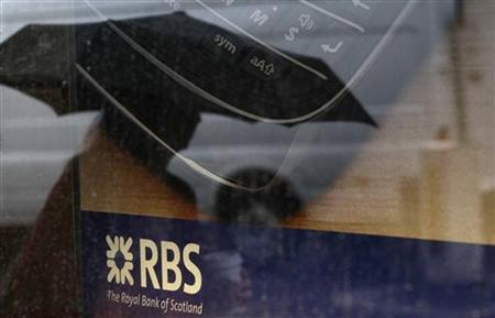 A pedestrian is reflected in the window of a branch of the Royal Bank of Scotland in London August 4, 2011. REUTERS/Suzanne Plunkett