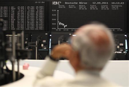 A trader reacts in front of the DAX board at the Frankfurt stock exchange September 12, 2011. REUTERS/Alex Domanski