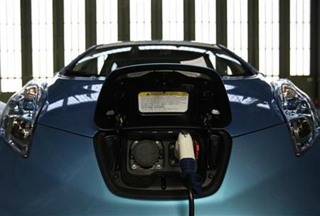 A Nissan Leaf electric car charges at the Challenge Bibendum sustainable mobility trade fair in Berlin May 18, 2011. REUTERS/Thomas Peter