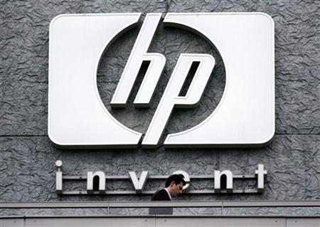 A man walks past the Hewlett Packard logo at its French headquarters in Issy le Moulineaux, western Paris, in this September 16, 2005 file photograph. REUTERS/Charles Platiau/Files