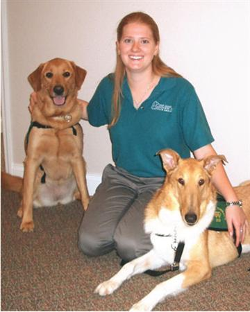 Andrea Cardona, founder of Florida's Four Legged Advocates, who trains canines to comfort children who have to testify in criminal cases poses in this undated handout photo. REUTERS/Four Legged Advocates/handout