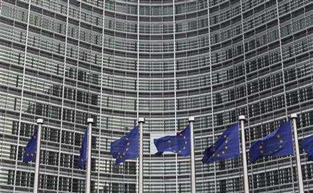 European Union flags are seen outside the European Commission headquarters in Brussels ahead of an EU heads of state summit, October 27, 2010. REUTERS/Francois Lenoir