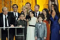 "<p>Ed O'Neill (L) accepts the award for outstanding ensemble for a comedy series for ""Modern Family"" with fellow cast members at the 17th annual Screen Actors Guild Awards in Los Angeles, California January 30, 2011. REUTERS/Mario Anzuoni</p>"