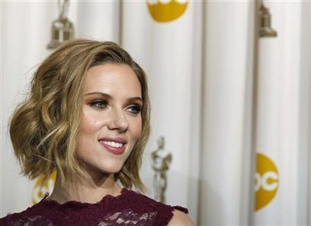 Presenter Scarlett Johansson is pictured backstage at the 83rd Academy Awards in Hollywood, California, February 27, 2011. REUTERS/Mike Blake