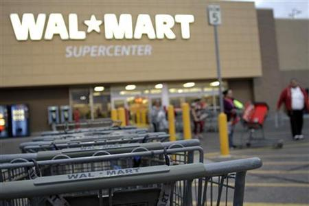 Shopping carts are seen outside a Wal-Mart Supercenter in Coolidge, Arizona December 6, 2010. REUTERS/Joshua Lott