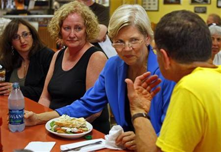 Elizabeth Warren speaks with voters as she campaigns after announcing her candidacy for the Senate in Framingham, Massachusetts, September 14, 2011. REUTERS/Adam Hunger