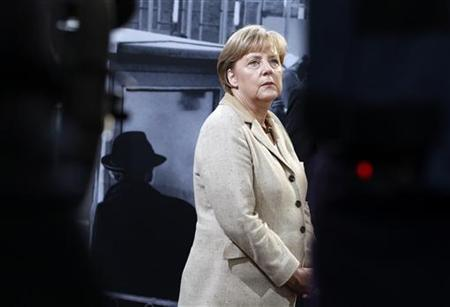 German Chancellor Angela Merkel attends the opening of the ''Grenzerfahrung'' (Border experiences) exhibition in the former Traenenpalast (Palace of Tears) East German border crossing station in Berlin, September 14, 2011. REUTERS/Thomas Peter
