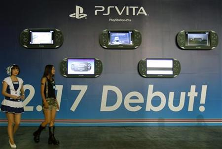 Promoters dressed as video game characters walk past an advertisement board of Sony's PlayStation Vita handheld gaming device at Tokyo Game Show in Chiba, east of Tokyo, September 15, 2011. REUTERS/Kim Kyung-Hoon