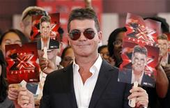 "<p>Judge Simon Cowell poses at the world premiere of the television series ""The X Factor"" at the Arclight Cinerama Dome in Hollywood, California September 14, 2011. REUTERS/Mario Anzuoni</p>"