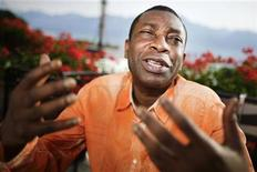 <p>Senegalese singer Youssou N'Dour gestures during an interview with Reuters before his concert at the 44th Montreux Jazz Festival in Montreux July 9, 2010. REUTERS/Valentin Flauraud</p>