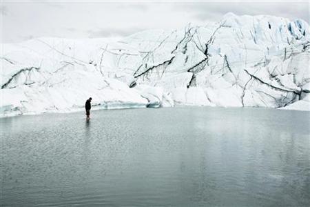 Hikers walk on the Matanuska Glacier near Palmer, Alaska August, 10 2008. REUTERS/Lucas Jackson/Files