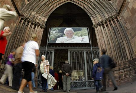 A huge poster showing a portrait of Pope Benedict XVI is placed over the entrance of the Freiburger Muenster (Freiburg Minster) in the south-western German town of Freiburg September 14, 2011. REUTERS/Arnd Wiegmann