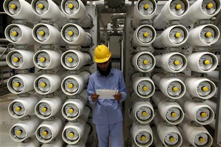 A worker stands at a desalination plant, 35 lm south of Riyadh, May 4, 2011. REUTERS/Fahad Shadeed
