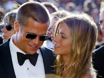 Actor Brad Pitt and his actress wife Jennifer Aniston arrive at the 56th annual Primetime Emmy Awards at the Shrine Auditorium in Los Angeles in this September 19, 2004 file photo. REUTERS/Kimberly White