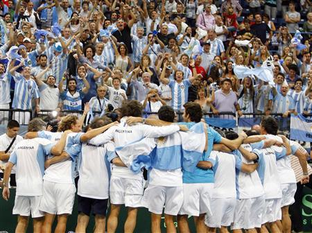 Argentina's players celebrate after beating Serbia in their Davis Cup World Group tennis semi-final match in Belgrade September 18, 2011. REUTERS/Novak Djurovic