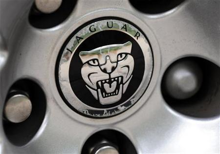 A Jaguar car logo is seen on a vehicle hubcap in central London September 24, 2009. REUTERS/Toby Melville