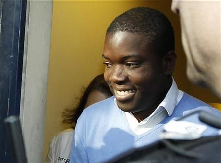 Kweku Adoboli leaves City of London Magistrates Court in London September 16, 2011. REUTERS/Luke MacGregor