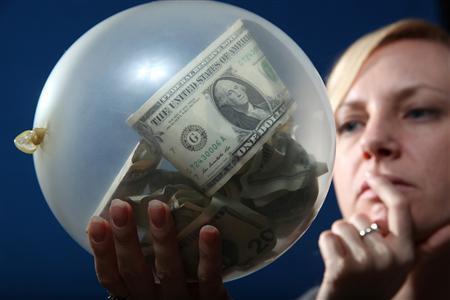A woman looks at U.S. bills in a balloon. REUTERS/Jill Kitchener