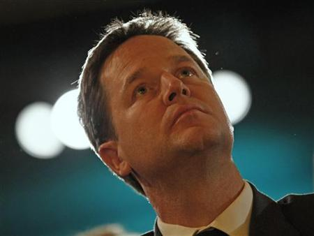 Nick Clegg, leader of the Liberal Democrats listens to a speech from Business Secretary Vince Cable during their annual autumn conference, in Birmingham, September 19, 2011. REUTERS/Darren Staples