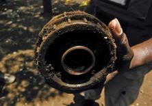 <p>A deminer working for the Swiss Foundation for Mine Action (FSD) shows anti-personnel landmine laid by separatist Tamil Tigers in Kannaddi, located in Mannar district in Sri Lanka September 8, 2011. Post-war Sri Lanka will need another decade to clear the half million landmines which lie buried under swathes of agricultural and forest land and around villages in the north of the island nation, the head of a demining group said. REUTERS/ALERTNET/Nita Bhalla</p>