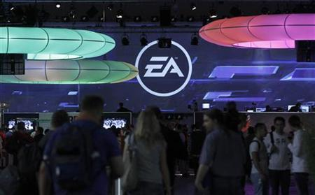 Visitors walk past the exhibition stand of Electronic Arts (EA) at the Gamescom 2010 fair in Cologne August 18, 2010. The Gamescom convention, Europe's largest video games trade fair, runs from August 18 to August 22. REUTERS/Ina Fassbender