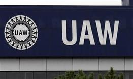 <p>The United Auto Workers union logo is seen on the front of the UAW Solidarity House in Detroit, Michigan, September 8, 2011. REUTERS/Rebecca Cook</p>