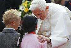 <p>Pope Benedict XVI speaks to young wellwishers on his arrival at Tegel International airport in Berlin September 22, 2011. Pope Benedict starts his most difficult visit yet to his German homeland on Thursday, touring mostly Protestant and atheist regions in the ex-communist east after previous visits to Catholic strongholds in the Rhineland and his native Bavaria. REUTERS/Thomas Peter</p>