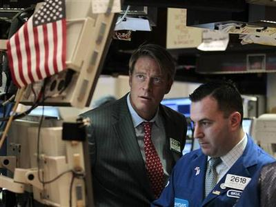 Barclays Capital traders Patrick Murphy and James Sculli work on the floor of the New York Stock Exchange September 22, 2011. REUTERS/Brendan McDermid