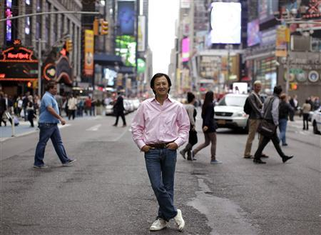 Color co-founder and CEO Bill Nguyen poses on the street in New York's Times Square, September 20, 2011. REUTERS/Brendan McDermid