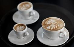 <p>Latte art is displayed during the finals of the German Barista Championships in Hamburg April 17, 2011. REUTERS/Morris Mac Matzen</p>