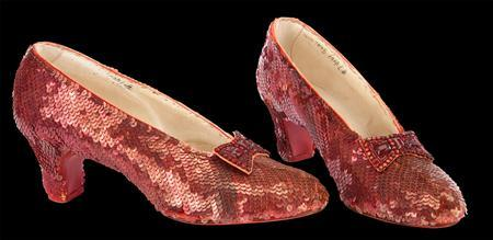A pair of the iconic ruby red slippers from ''The Wizard of Oz'' believed to have been worn by Judy Garland's Dorothy when she clicks her heels to return home to Kansas near the end of the film are seen in this undated handout photo. REUTERS/Handout
