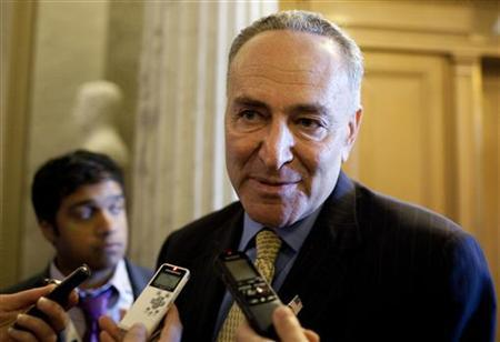 Senator Charles Schumer speaks to the media before voting on a bill allowing a rise in the debt ceiling on Capitol Hill in Washington August 2, 2011. REUTERS/Joshua Roberts