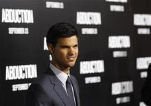 "<p>Cast member Taylor Lautner poses at the world premiere of ""Abduction"" at the Grauman's Chinese theatre in Hollywood, California September 15, 2011. The movie opens in the U.S. on September 23. REUTERS/Mario Anzuoni</p>"