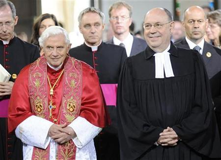 Pope Benedict XVI and Nikolaus Schneider (R), Chairman of the Council of the Evangelical Church in Germany (EKD) attend the Ecumenical Service of the World in the church of the Augustinian Monastery in Erfurt, September 23, 2011. REUTERS/Norbert Neetz/Pool