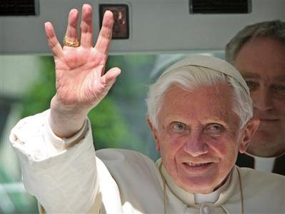Pope Benedict XVI waves to wellwishers as he arrives in his Popemobile at the Freiburger Cathedral (Freiburg Minster) in the southwest German town of Freiburg September 24, 2011. REUTERS/Daniel Roland/Pool