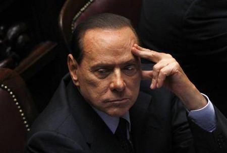 Italy's Prime Minister Silvio Berlusconi attends during a debate at the lower house of parliament in Rome in Rome September 22, 2011. Picture taken September 22, 2011. REUTERS/Alessandro Bianchi