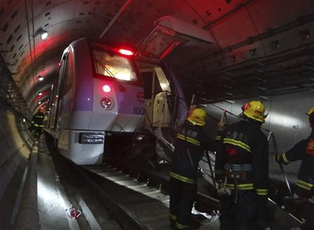 Firemen work to evacuate injured people in the underground tunnel of Line 10 after a train collision in Shanghai September 27, 2011. REUTERS/China Daily