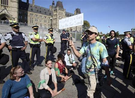 Demonstrators stage a ''sit in'' after crossing a police barricade during a protest against the Keystone XL pipeline on Parliament Hill in Ottawa September 26, 2011. Dozens were arrested in the protest against the pipeline that, if completed, will stretch from Canada to the gulf coast of the United States. REUTERS/Patrick Doyle