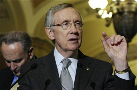 U.S. Senate Majority Leader Harry Reid (D-NV) (C) talks to reporters about the Senate's vote on debt ceiling legislation at the U.S. Capitol in Washington, August 2, 2011. REUTERS/Jonathan Ernst)