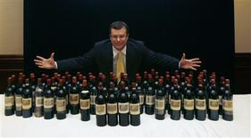 "<p>Acker Merrall & Condit's President and Auction Director John Kapon poses with a lot of 70 ""Four Centuries of Chateau Lafite Rothschild"" bottles, which includes bottles between 1799 and 2003, during a news conference in Hong Kong March 24, 2010. REUTERS/Bobby Yip</p>"