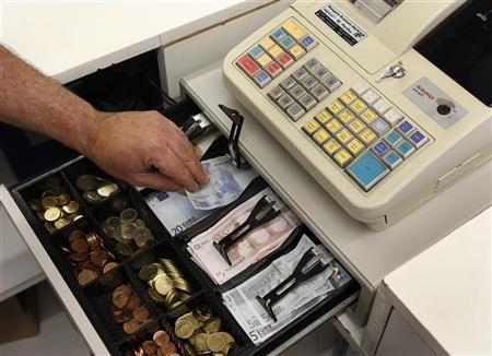 Euro banknotes and small coins are pictured in open cash register in a shop in Olching August 16, 2011. REUTERS/Michaela Rehle