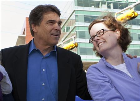 Republican presidential candidate and Texas Governor Rick Perry (L) stands with advisor Deirdre Delisi (R) at a campaign event in Austin, Texas in this file photo taken on April 9, 2010. Delisi was formerly Governor Perry's chief of staff and now serves as a senior policy advisor to his presidential campaign. Picture taken April 9, 2010. REUTERS/Bob Daemmrich