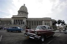 <p>A car is driven past the city capitol building in Havana September 28, 2011. REUTERS/Desmond Boylan</p>