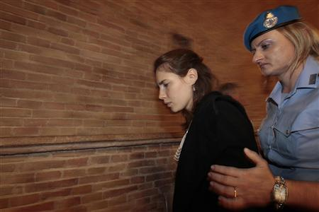 Amanda Knox leaves the court during her appeal trial session in Perugia, September 26, 2011. REUTERS/Alessandro Bianchi