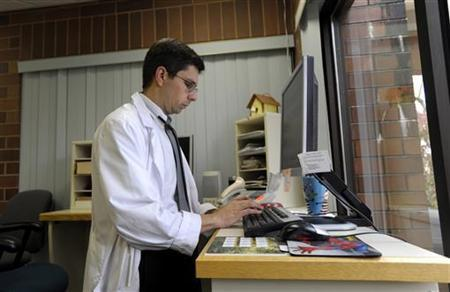 Geisinger Health System pediatrician Dr. James Zolla enters and reviews patient medical information in the Geisinger Health System electronic health records system at the Geisinger Clinic in Selinsgrove, Pennsylvania, October 28, 2009. REUTERS/Brad Bower