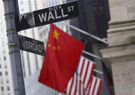 A Chinese flag flies outside the New York Stock Exchange, November 20, 2009. REUTERS/Brendan McDermid