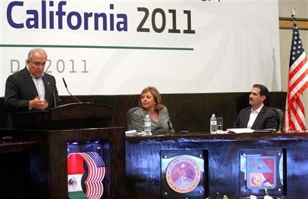 Governor of Baja California Guadalupe Osuna Millan (L) addresses the audience next to Governor of New Mexico Susana Martinez (C) and Governor of Sonora Guillermo Padres Elias at the annual conference of regional leaders from both sides of the border in Sonora September 29, 2011. REUTERS/Jorge Duenes